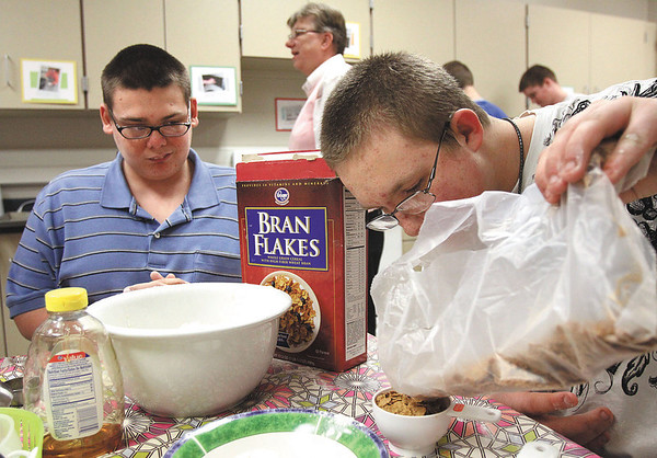 Cody Randall, right, and Cody Jewell mix a bowel of batter for dog treats in the Jeffersonville High School Barkery on Friday.  Proceeds for the treats are being donated to the Josephine B. Ogle Animal Shelter and the Clark County Humane Society for care of animals displaced by the tornadoes.  Staff photo by C.E. Branham