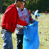 New Albany Navy JROTC cadets Brendyn Morgan and Dylan Cook pick up debris on the Luttrell farm in Pekin. Staff photo by C.E. Branham