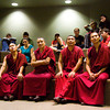 From left, buddhist monks Tenpa Phuntsok, Geshe Palden, Yeshi Nyingdak, and Mon. Tenpa Dhargya, from the Tashi Kyil Monastery in Dehra Dun, India, take questions from students during a visit to Community Montessori in New Albany on Wednesday afternoon. They are part of a group of seven monks visiting the United States to help educate the public on Tibetan religion and culture. Staff photo by Christopher Fryer