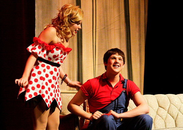 """Hannah Hartman, left, portrays Daisy Mae Scraggs and David Kane portrays Li'l Abner Yokum during a dress rehearsal for the musical """"Li'l Abner"""" in the auditorium at New Albany High School on Wednesday night. The production opens Friday evening. Staff photo by Christopher Fryer"""