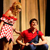 "Hannah Hartman, left, portrays Daisy Mae Scraggs and David Kane portrays Li'l Abner Yokum during a dress rehearsal for the musical ""Li'l Abner"" in the auditorium at New Albany High School on Wednesday night. The production opens Friday evening. Staff photo by Christopher Fryer"