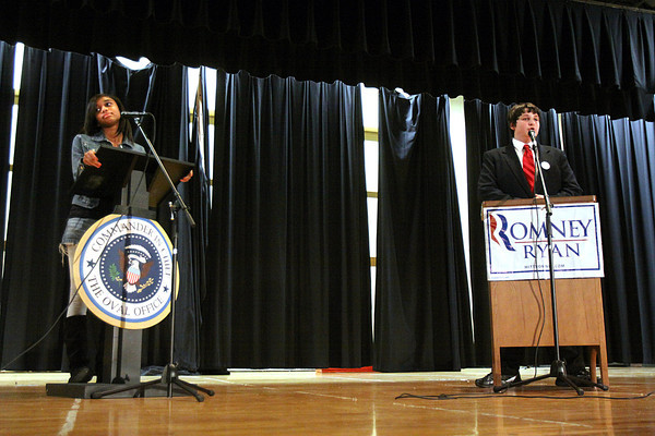 Parkview Middle School eighth-graders Gabrielle Yowell, left, and Josh Waddell participate in a mock presidential debate Thursday. Five members of the advanced social studies class studied debate topics such as gun control, same sex marriage, and taxes for three weeks in preparation. Staff photo by C.E. Branham