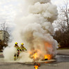 A plume of smoke rises through the air as fire rescue students use portable fire extinguishers during a chemical fire training exercise at Prosser Career Education Center in New Albany on Thursday morning. Staff photo by Christopher Fryer