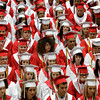 Seniors in the class of 2012 wait to receive their diplomas during their commencement ceremony in the gymnasium at Jeffersonville High School on Friday night. Staff photo by Christopher Fryer
