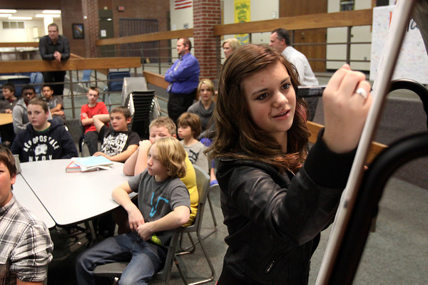 Charlestown Middle School seventh-grader Mia Pappas writes down student behaviors her peers said they would like changed during a Rachel's Challenge event Wednesday. Staff photo by C.E. Branham