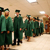 Seniors in the class of 2012 wait to enter the gymnasium for their commencement ceremony at Floyd Central High School on Friday night. Staff photo by Christopher Fryer