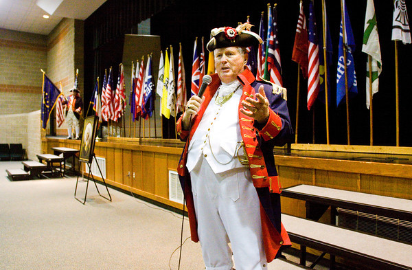 Tom Green, Pearland, Texas, of the Texas Society of the Sons of the American Revolution, speaks to Highland Hills Middle School students during a program on historic flags and their place in American history in the auditorium of the school on Thursday afternoon. Staff photo by Christopher Fryer