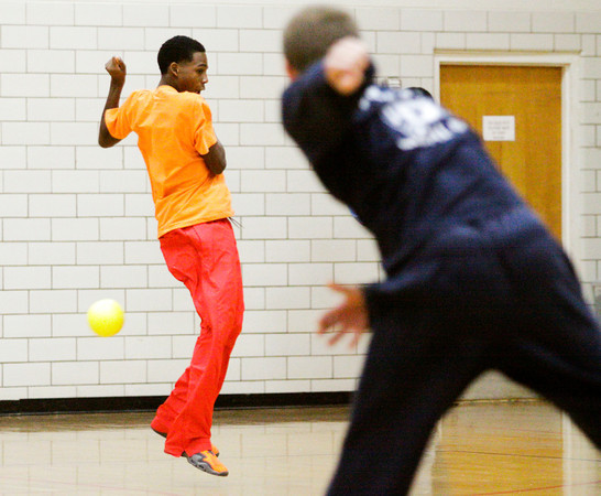 James Thornton attempts to avoid a throw during a dodgeball tournament at Parkview Middle School in Jeffersonville on Friday afternoon. The tournament was organized as a reward for the school's Positive Behavior System where students earn points they can trade in every nine weeks. Staff photo by Christopher Fryer