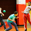 Jacob Laughlin, left, braces for impact after Blake Ellis, center, and Craig Murphy narrowly missed being hit during a dodgeball tournament at Parkview Middle School in Jeffersonville on Friday afternoon. The tournament was organized as a reward for the school's Positive Behavior System, where students earn points they can trade in every nine weeks. Staff photo by Christopher Fryer