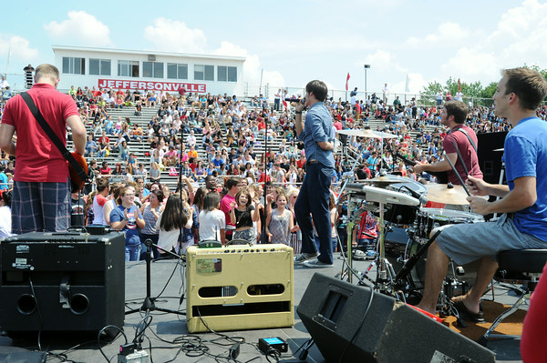 The Jeffersonville High School student body enjoys a performance by JHS alumni, The Juice Box Heroes, in celebration of PRIDE, which stands for Persistence, Respectfulness, Initiative, Dependability and Efficiency, on the JHS football field Friday afternoon. The celebration was able to combine the kick-off the behavioral expectations for students and the start of the new school year.<br /> Staff photo by Tyler Stewart
