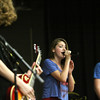 "Katie Uhl, center, and members of the band Under Construction perform Wednesday at Charlestown Middle School. The band, made up of students from Clark and Floyd County, played during lunch as part of Red Ribbon Week activities tabbed, ""Band together against drugs."" Staff photo by C.E. Branham"