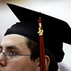 Senior Carl Brown waits to receive his diploma during the commencement ceremony for the class of 2012 in the gymnasium at New Albany High School on Friday night. Staff photo by Christopher Fryer