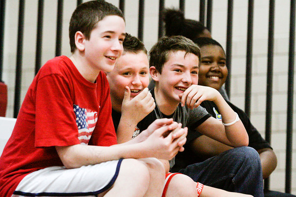 From left, Wyatt Kimmel, Justin Vales and Ethan Badger laugh as they watch a match during a dodgeball tournament at Parkview Middle School in Jeffersonville on Friday afternoon. The tournament was organized as a reward for the school's Positive Behavior System, where students earn points they can trade in every nine weeks. Staff photo by Christopher Fryer
