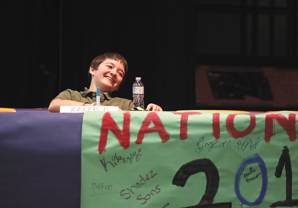 River Valley Middle School seventh-grader Kaleb Busby leans back in relief after winning the National Geographic Bee competition Wednesday morning at the Jeffersonville school.  Staff photo by C.E. Branham