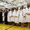 Seniors in the class of 2012 scan the audience during their commencement ceremony in the gymnasium at New Albany High School on Friday night. Staff photo by Christopher Fryer