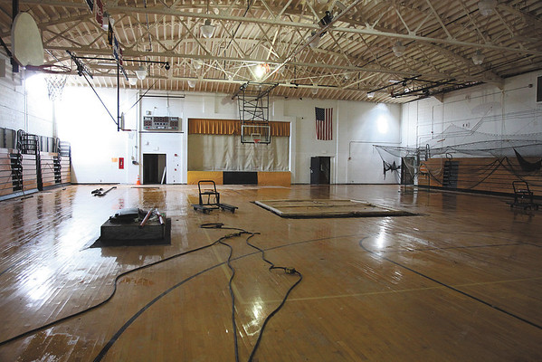 Spurgeon Gymnasium suffered some roof damage and a hole in the wall which is back left in this photo. Staff photo by C.E. Branham