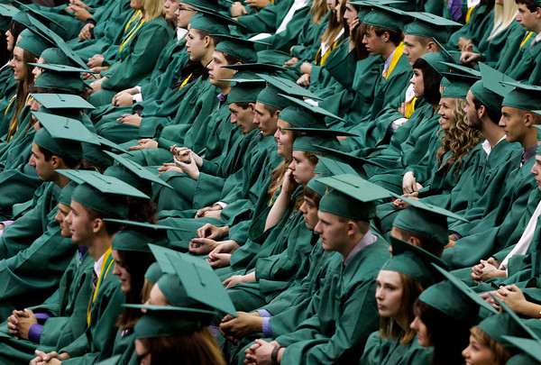 Seniors in the class of 2012 wait to receive their diplomas during their commencement ceremony in the gymnasium at Floyd Central High School on Friday night. Staff photo by Christopher Fryer