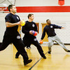 Jeffersonville firefighters approach the center line to throw during a dodgeball tournament at Parkview Middle School in Jeffersonville on Friday afternoon. The firefighters were at the tournament to help organize it and compete against the top teams. The tournament was put on as a reward for the school's Positive Behavior System, where students earn points they can trade in every nine weeks. Staff photo by Christopher Fryer