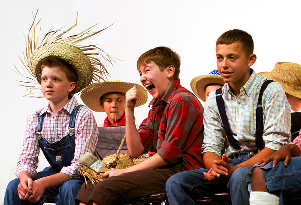 From left, Highland Hills Middle School seventh graders Gage Griffin, Ethan Worrall, Sage Cummins, and Trysten Williams sit on stage during Tom Sawyer Day in the school auditorium on Tuesday afternoon. Worrall placed first and Cummins placed second in the Tom Sawyer look-alike contest. Other categories in the contest included Becky Thatcher, Huck Finn and Tomboy Sawyer. Staff photo by Christopher Fryer