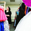 Junior Leslie Janes, 17, browses through the racks in the Cinderella Shoppe, where students can rent prom attire and accessories, at New Albany High School on Wednesday afternoon. Staff photo by Christopher Fryer