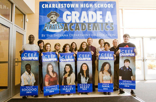 Community and educational leaders stand with students after they were presented with their Charlestown Excellence in Education Foundation banners at Charlestown High School on Monday morning. Currently, more than 90 percent of the school's seniors have been recognized with banners, which will be displayed along Market Street and are designed to recognize academics on the same level as athletics. Only students who have been accepted to a college, vocational school or the military qualify for the program. Staff photo by Christopher Fryer
