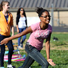 Olivia Robinson takes off in a game of red light, green light during the Chicken Run Too and Golden Egg Games Thursday at River Valley Middle School. Staff photo by C.E. Branham