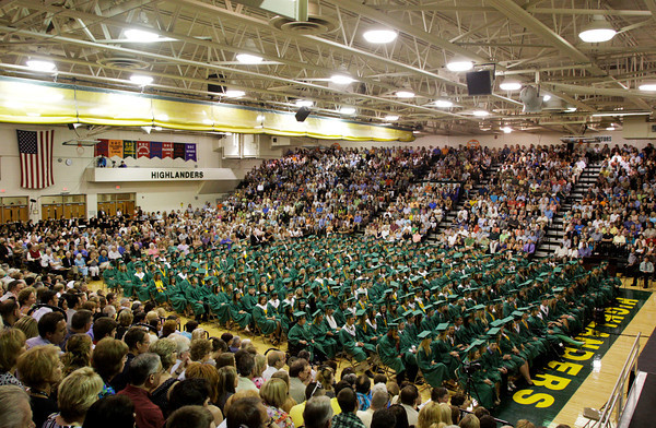 Friends and family members look on as seniors in the class of 2012 wait to receive their diplomas during their commencement ceremony in the gymnasium at Floyd Central High School on Friday night. Staff photo by Christopher Fryer