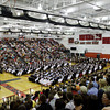 Seniors in the class of 2012 listen to speakers during their commencement ceremony in the gymnasium at New Albany High School on Friday night. Staff photo by Christopher Fryer