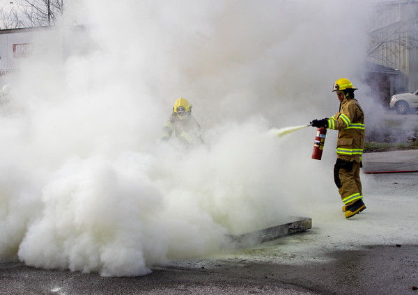 Fire rescue students work to put out a chemical fire during a class on portable fire extinguisher use at Prosser Career Education Center in New Albany on Thursday morning. Staff photo by Christopher Fryer