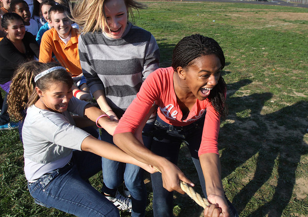 River Valley Middle School eighth-graders Jhala Henry, right, Allie Whalen, center and Zacchaea Stiles play tug of war as part of the Golden Egg Games and Chicken Run Too Thursday afternoon at the Jeffersonville School. The activities, sponsored by the student Make A Difference club, concluded a two week fund drive for Kosair Children's Hospital. Staff photo by C.E. Branham
