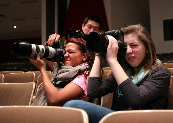 Jeffersonville High School advanced photo class students Erica Hale, left, and Meghan Haas shoot a fashion show at the school Wednesday morning. The photo class and fashion club organized the show and Andrew Kung Photography supplied cameras and tips on shooting fashion. Staff photo by C.E. Branham