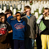 Hazelwood Middle School students salute the American flag during a wreath laying ceremony at the New Albany National Cemetery on Friday afternoon. The entire fifth-grade class from the school placed 270 wreaths around the cemetery to honor veterans for the holiday season as part of Wreaths Across America. Staff photo by Christopher Fryer