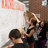Close to 100 Charlestown Middle School students signed a banner accepting Rachel's Challenge Wednesday. The program goal is to reduce bullying and harassment in schools. Staff photo by C.E. Branham