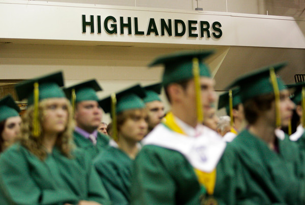 Seniors in the class of 2012 listen to speakers during their commencement ceremony in the gymnasium at Floyd Central High School on Friday night. Staff photo by Christopher Fryer