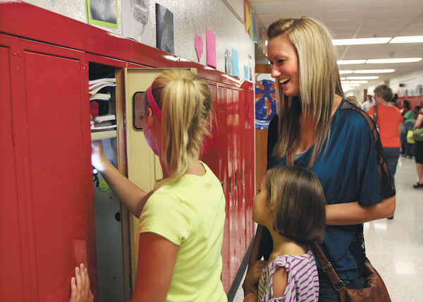 Parkview Middle School sixth-grader Alyssa Tyree shows her mother Shawna Middleton, and sister Autumn Middleton, a battery powered light she installed in her locker during open house Tuesday. Staff photo by C.E. Branham