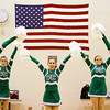 The Floyd Central Dazzlers perform their pom routine during a preview show in the auxiliary gym at Floyd Central High School on Tuesday evening. The 18-member team left on Wednesday evening to compete in the Universal Dance Association's National Dance Team Championship this coming weekend in Orlando Fla. Staff photo by Christopher Fryer