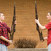 Fraternal twins Dillon, right, and Nathan Burres, both senior cadets on the New Albany High School Navy JROTC Drill Team, practice their duel routine after school in New Albany on Tuesday afternoon. Staff photo by Christopher Fryer