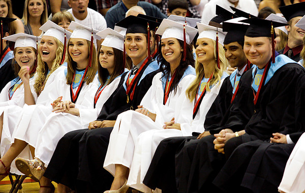 Seniors in the class of 2012 listen to a speech by their classmate Alex Stewart  during their commencement ceremony in the gymnasium at New Albany High School on Friday night. Staff photo by Christopher Fryer
