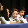 Adian Wood watches as classmate Leslie Venzor answers her question in the 10th annual National Geographic Bee competition Tuesday morning at River Valley Middle School. Staff photo by C.E. Branham