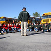 Lt. Col. Ben Gipe talks with NJROTC cadets from New Albany High School and Floyd Central High School before they head out to farms in Pekin Wednesday morning to clear fields of debris. Staff photo by C.E. Branham