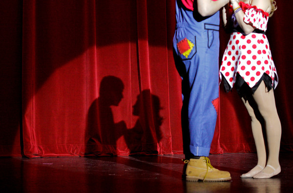 "Hannah Hartman, right, portrays Daisy Mae Scraggs and David Kane portrays Li'l Abner Yokum during a dress rehearsal for the musical ""Li'l Abner"" in the auditorium at New Albany High School on Wednesday night. The production opens Friday evening. Staff photo by Christopher Fryer"