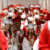 Seniors in the class of 2012 wait to enter the gymnasium for their commencement ceremony at Jeffersonville High School on Friday night. Staff photo by Christopher Fryer