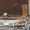 Belfor workers removing the flooring from Furnish Gymnasium at Henryville High School. Staff photo by C.E. Branham