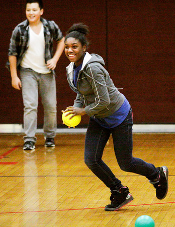 Alexis Reed moves to make a throw during a dodgeball tournament at Parkview Middle School in Jeffersonville on Friday afternoon. The tournament was organized as a reward for the school's Positive Behavior System, where students earn points they can trade in every nine weeks. Reed was the only girl who signed up to play. Staff photo by Christopher Fryer