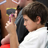 Corden Porter sixth-grader Justin Chavez, a member of the library advisory council, filmed the library dedication. Staff photo by C.E. Branham