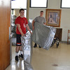 Pat Minenok (right) and Nick Treloar carry new mattresses into residents' rooms at Golden Hill.