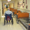 Mary Grzebieniak/NEWS<br /> This corridor at Golden Hill Nursing Home was lined with old beds while athletes from New Castle High School and Slippery Rock University assembled and delivered new beds to the residents Monday.