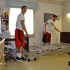 Mary Grzebieniak/NEWS<br /> Micah Fulena  (left) and Robert Natale, New Castle High School athletes, deliver a bed to a resident room at Golden Hill Nursing Home Monday.