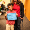 Xander showing off his Achievement Award with his teacher, Mrs. Batres.