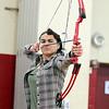 Ayer Shirley Regional High School junior Megan Conversano gets ready to shoot an arrow during Physical Education teacher Jamie Lamoreaux archery class on Wednesday afternoon. SENTINEL & ENTERPRISE/ JOHN LOVE